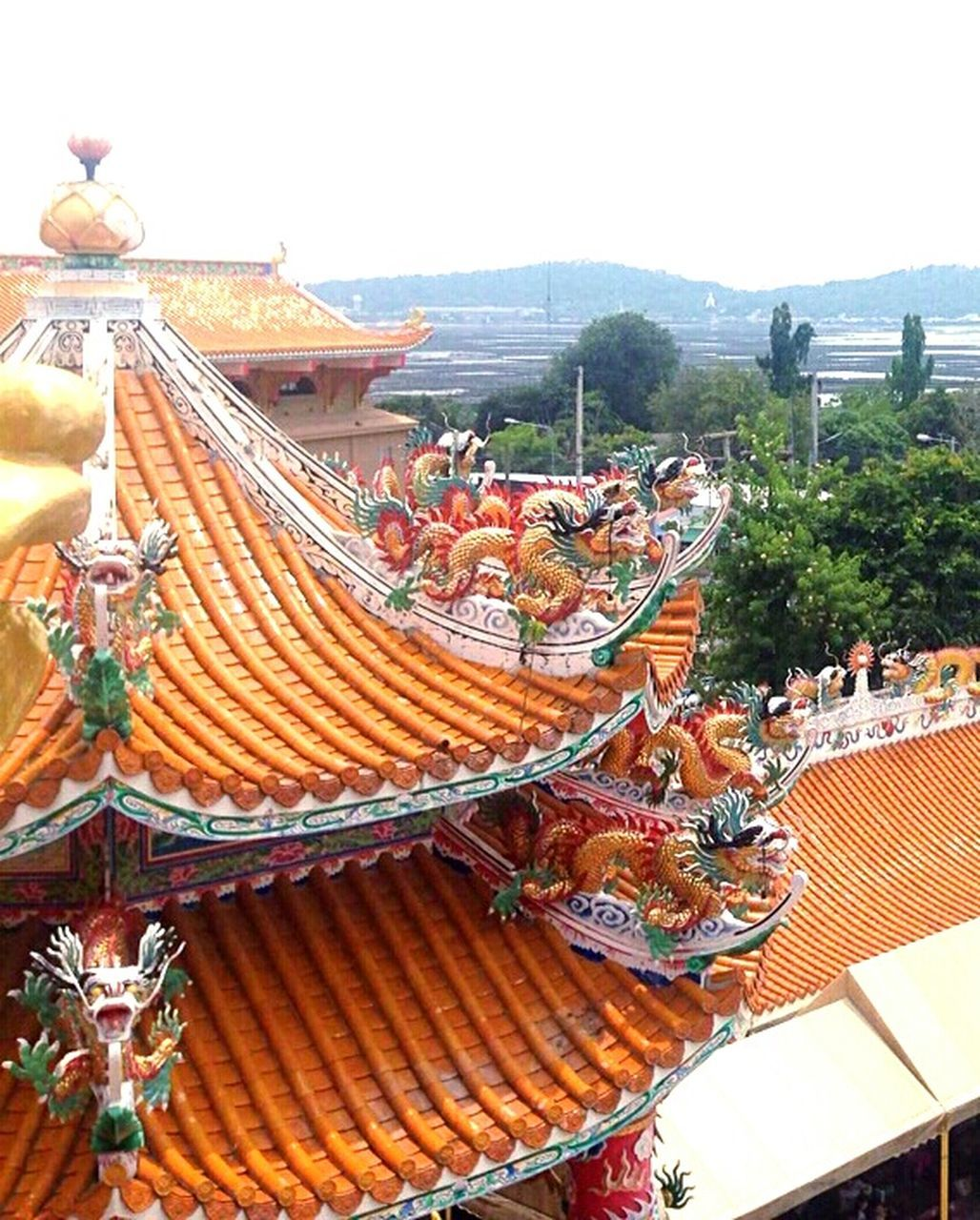 day, outdoors, roof, built structure, architecture, building exterior, dragon, no people, sky, chinese dragon