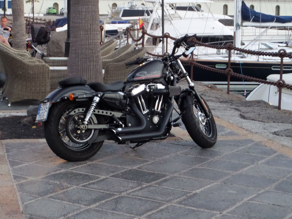 Background. Black Colour Black Motorcycle. Black. Boats. Day Land Vehicle Mode Of Transport No People One Outdoors Parked Stationary Tiles Tiling Transportation