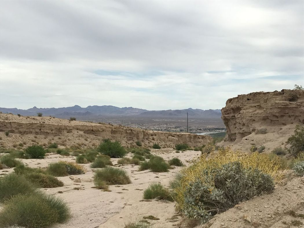 Landscape Nature Sky Tranquil Scene Desert Scenics Sand Arid Climate Tranquility Cloud - Sky Beauty In Nature Sand Dune Day Outdoors Bush Mountain No People Grass River View City View  Dry Wash Geology