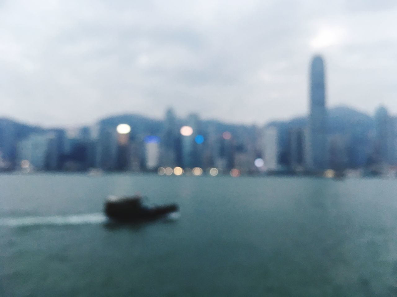 City Building Exterior Architecture Water Built Structure Cityscape No People Waterfront Sky Ship HongKong Skyline Skyscraper Travel Destinations Sea Urban Skyline Modern Day Nature
