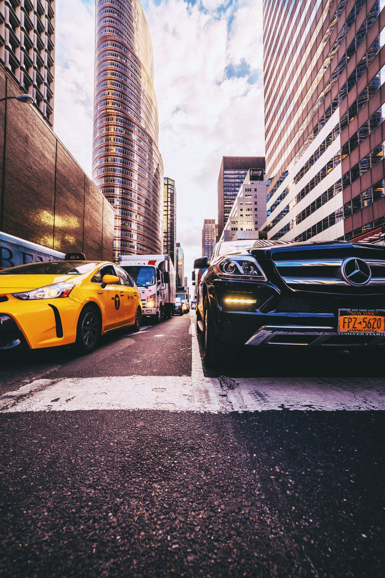 Came out to play. City Car Yellow Taxi Taxi Skyscraper Transportation Traffic City Life Yellow Building Exterior Architecture Road Cityscape No People Outdoors Day Sky NYC Street City Cityscape NYC Photography Travel Destinations Architecture Built Structure