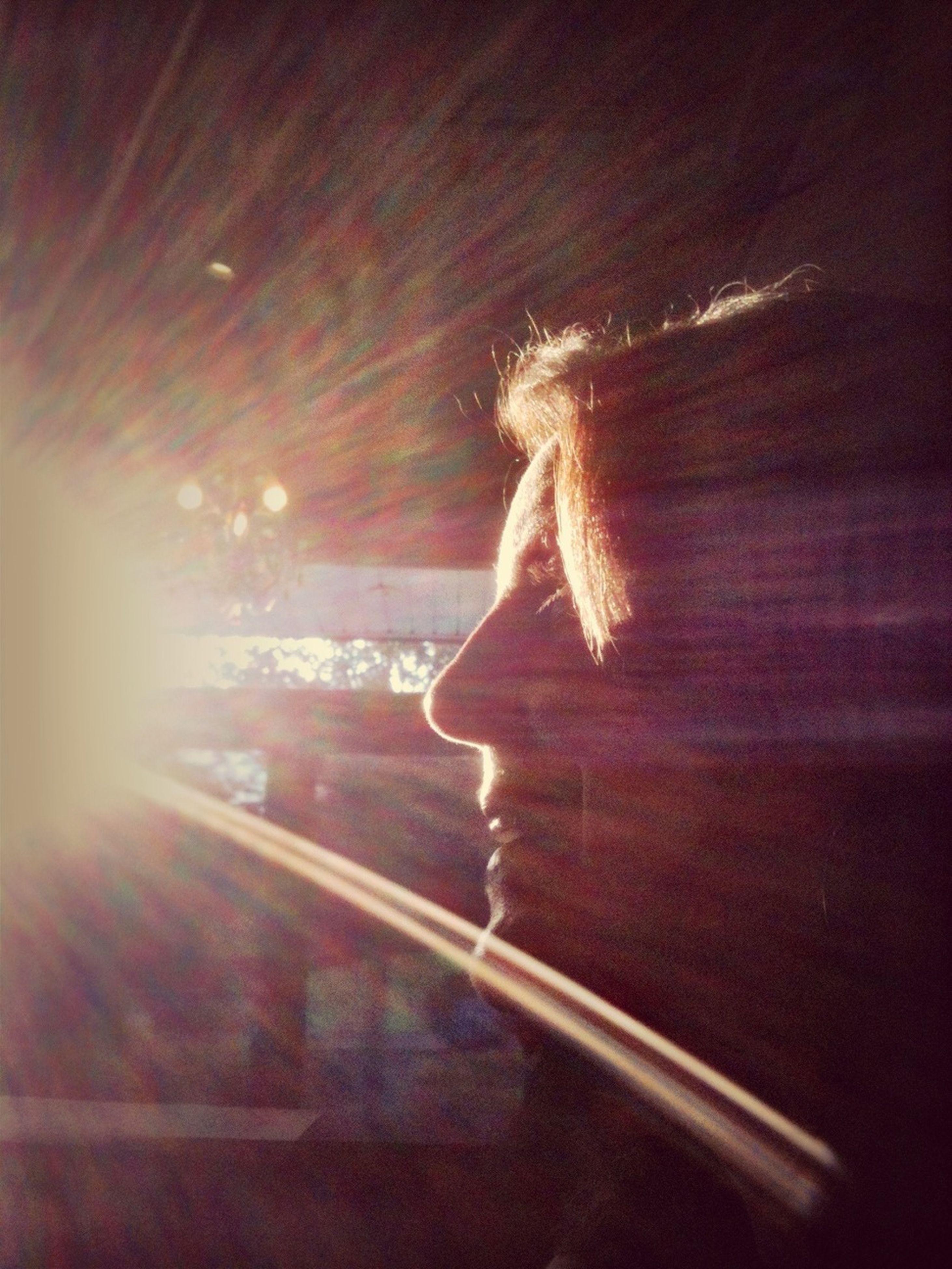 night, illuminated, transportation, road, street, lens flare, full length, lifestyles, motion, car, rear view, blurred motion, the way forward, sunbeam, glowing, leisure activity, sunlight, light - natural phenomenon
