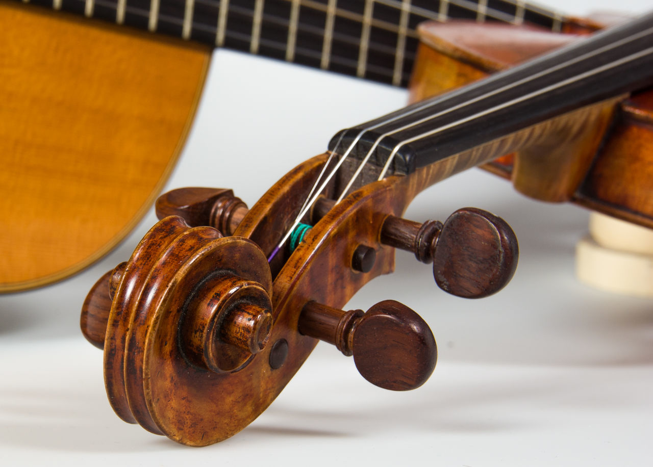 Detail Shot Of Cello By Guitar