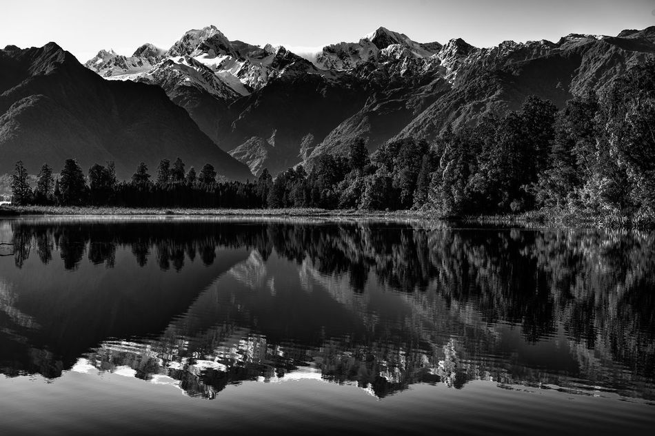 Beauty In Nature Black And White Black And White Photography The Secret Spaces Forest Lake Lake Matheson Landscape Mirroring In Water Mount Cook Mount Tasman Mountain Mountain Range Nature No People NZ Outdoors Reflection Scenics Sky Snow Travel Destinations Tree Water Welcome To Black