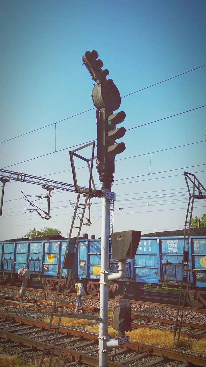 Low Angle View Of Railway Signal Against Clear Sky