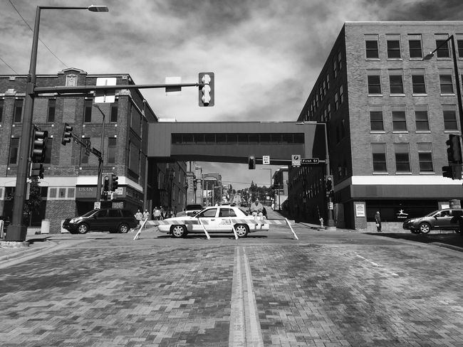 June 18, 2016 Architecture Building Building Exterior Built Structure City City Life City Street Cloud Cloud - Sky Day Diminishing Perspective Duluth Film Noir Land Vehicle Lifestyles Minnesota Mode Of Transport Monochrome Outdoors Parking Road Sky Street The Way Forward Vanishing Point