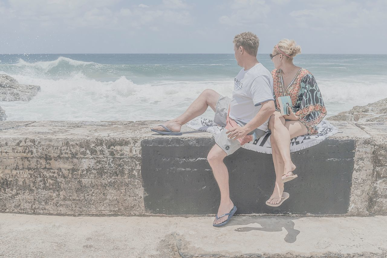 MelbournePhotographer People Watching People On The Beach Two People Togetherness Sea Beach Full Length Vacations Love Bonding Heterosexual Couple Adults Only Sand Travel Young Women Adult Young Adult People Women Happiness Friendship Outdoors