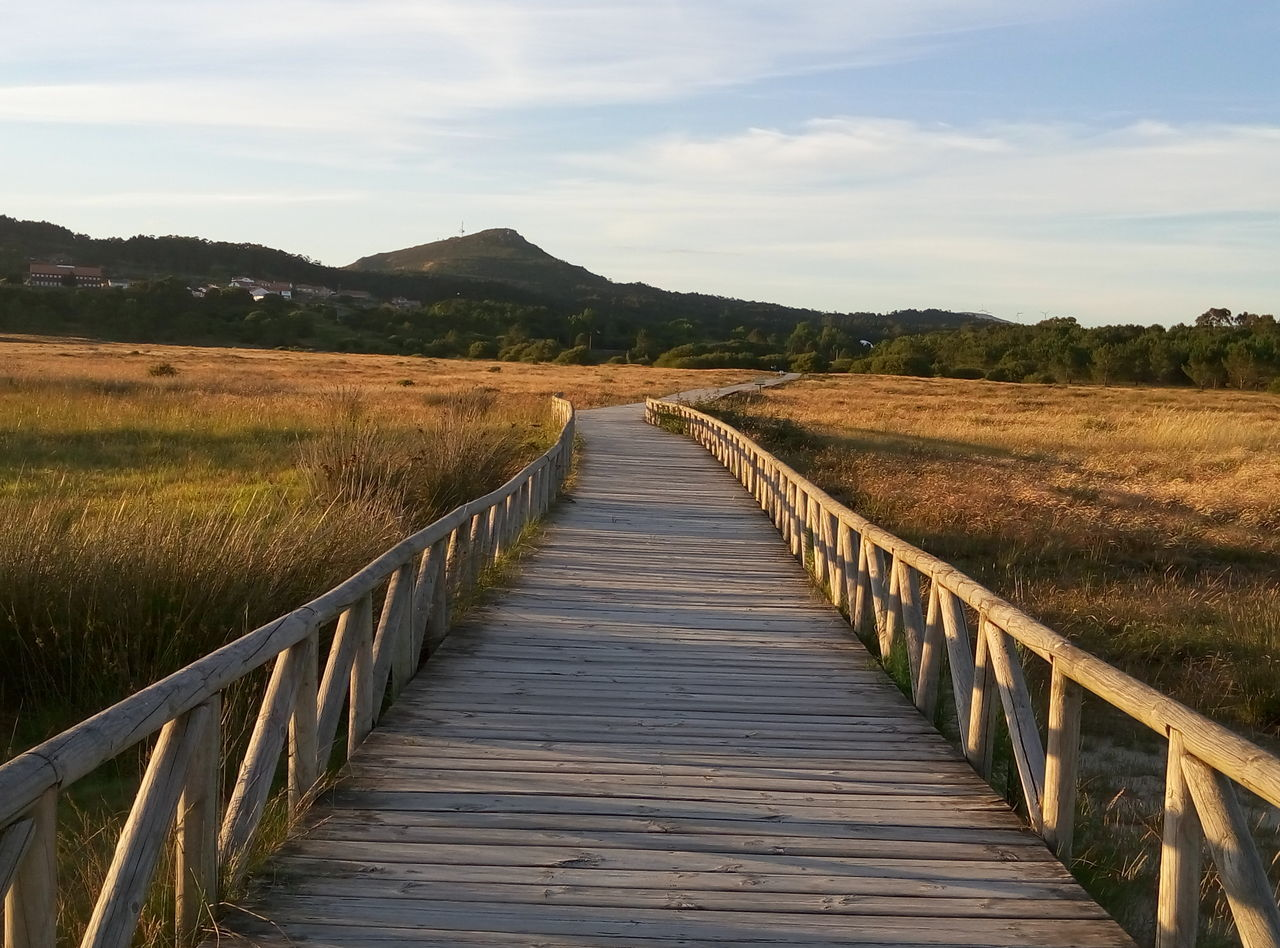 Beach Beauty In Nature Boardwalk Cloud - Sky Diminishing Perspective Duna De Corrubedo Galicia Spain Grass Idyllic Landscape Leading Mountain Narrow Nature No People Non-urban Scene Outdoors Plant Scenics Sky The Way Forward Tranquil Scene Tranquility Vanishing Point Walkway