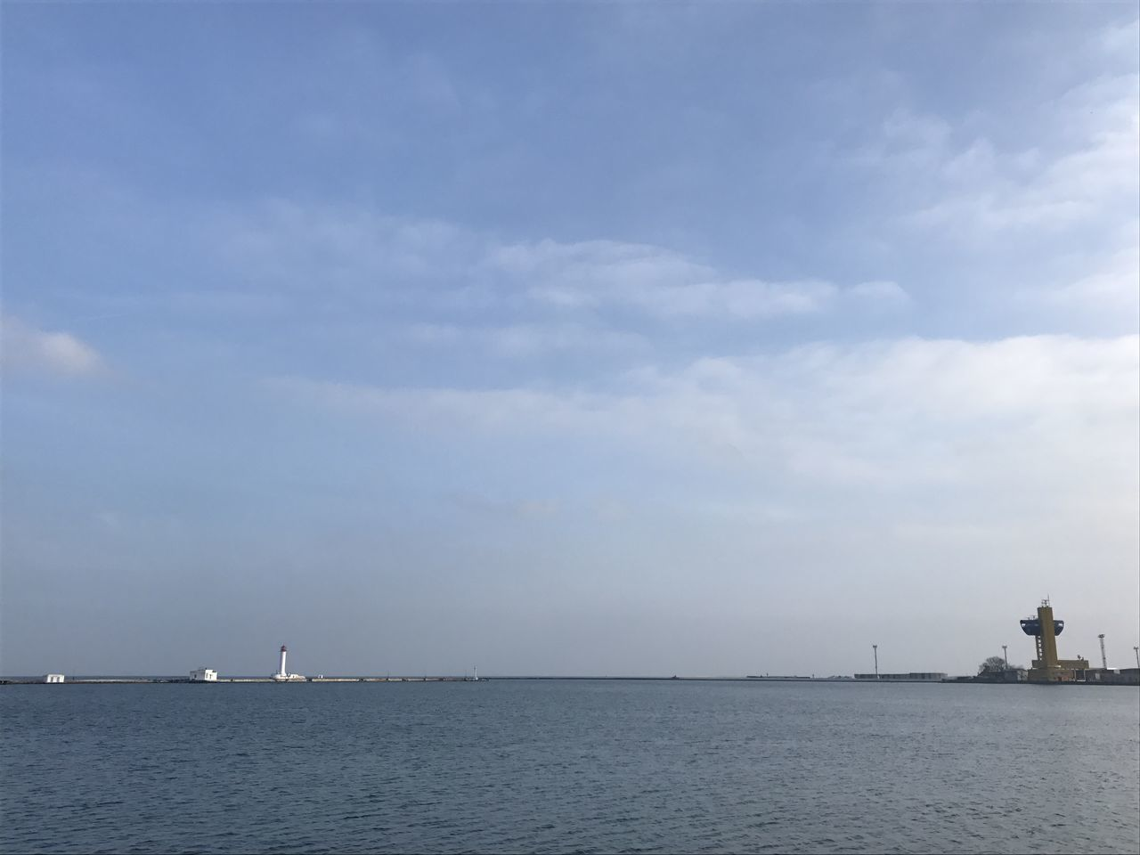 sea, sky, cloud - sky, scenics, waterfront, tranquility, water, beauty in nature, horizon over water, day, nature, outdoors, tranquil scene, no people, nautical vessel, sailing, architecture