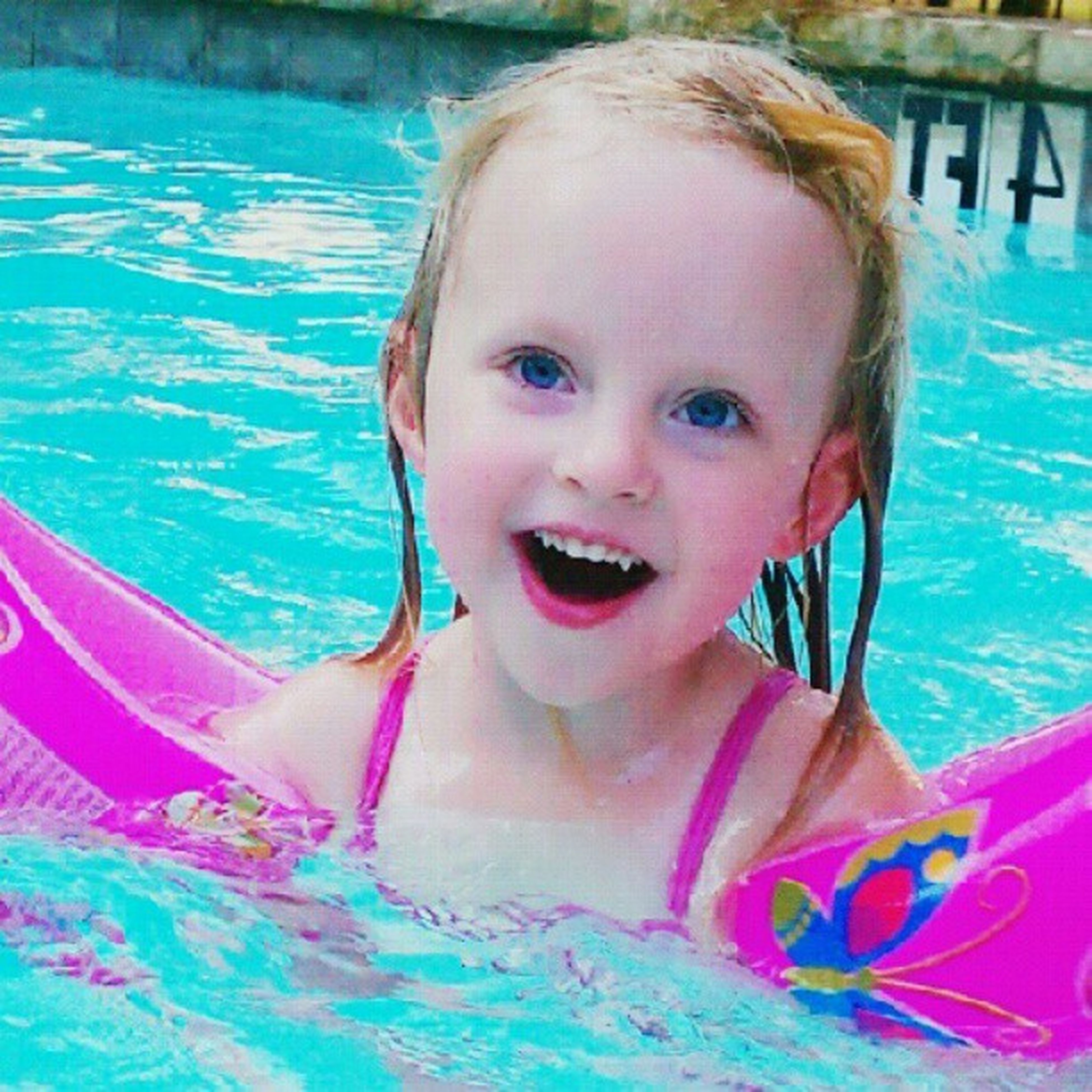 childhood, person, elementary age, water, innocence, portrait, leisure activity, girls, looking at camera, cute, lifestyles, headshot, swimming pool, boys, blue, smiling, front view, happiness