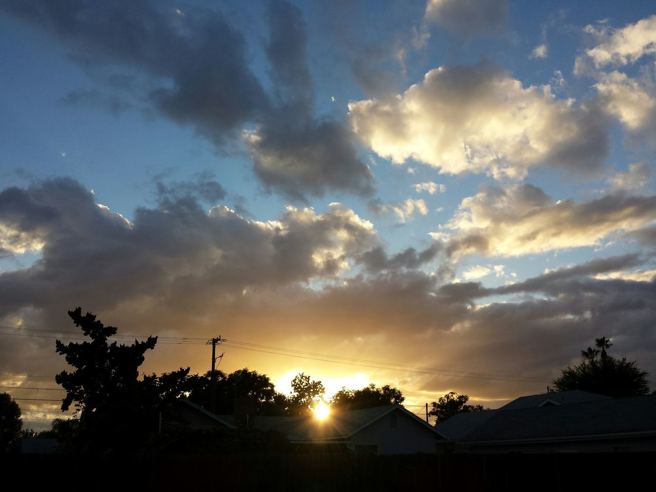 sunset, cloud - sky, sky, silhouette, nature, beauty in nature, scenics, no people, built structure, tree, tranquil scene, outdoors, tranquility, building exterior, architecture, day