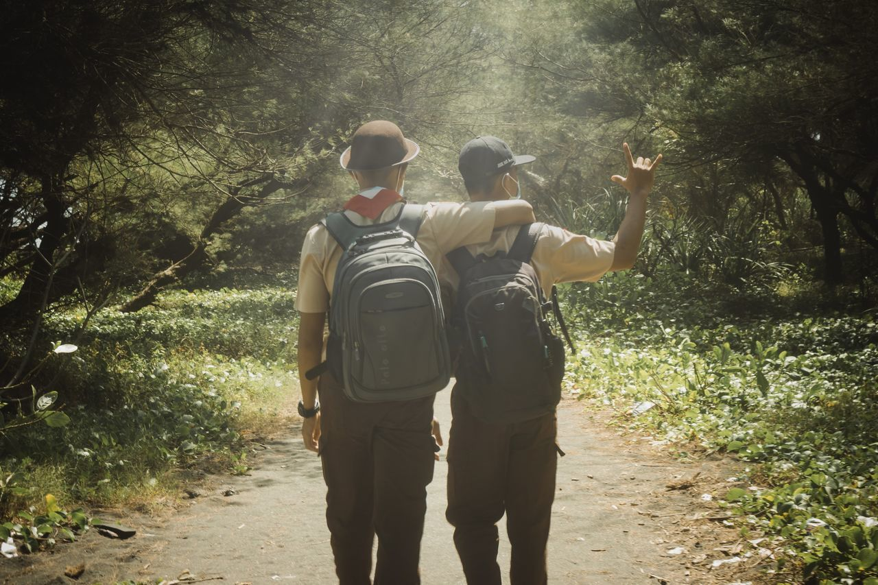 Togetherness Rear View Real People Adult Day Happiness People Outdoors Sunlight Nature Men Shadow Friendship Scout Beauty In Nature Nature Sunlight Forest Casual Clothing Vacations