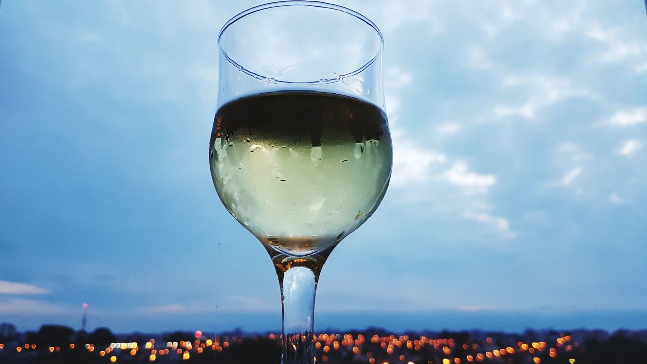 City Life Alcohol Drink Drinking Glass Wine Food And Drink Refreshment Champagne Wineglass Celebration Summer No People Nightlife Sky Cold Temperature Relaxing City Landscape Taking Photos Perfectview