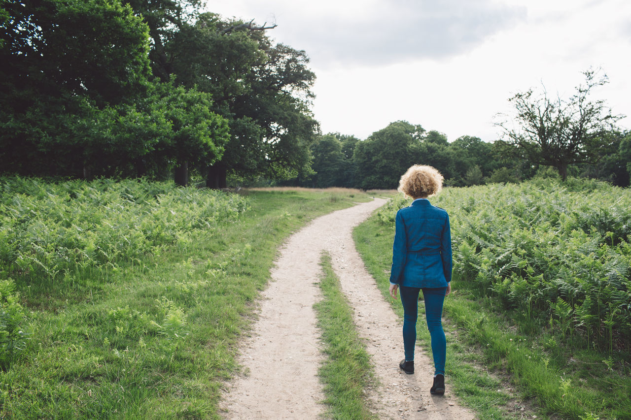 Beauty In Nature Casual Clothing Childhood Curly Hair Day Field Full Length Grass Green Color Growth Landscape Lifestyles Nature One Person Outdoors Plant Real People Rear View Richmond Park, London Road Scenics Sky The Way Forward Tree Walking