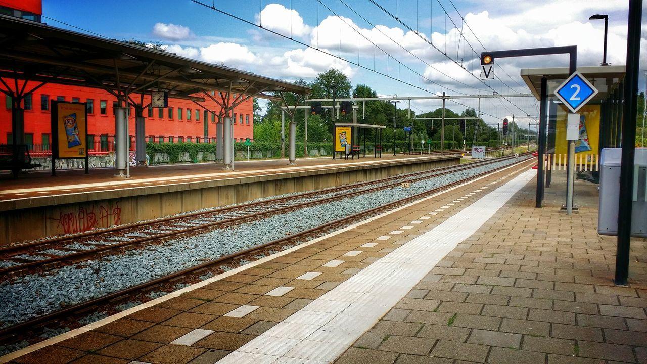 railroad track, transportation, rail transportation, railroad station platform, railroad station, public transportation, empty, no people, sky, day, outdoors
