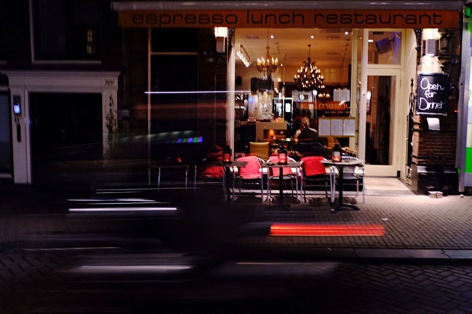Architecture Night Chair Urban Lifestyle Cycling Urban Exploration Land Vehicle Street Cityscape Motion Blur Outdoors City Street Amsterdam Light And Shadow City At Night Fujifilm X-pro2 Building Exterior Night Lights Illuminated Outdoor Restaurant Real People