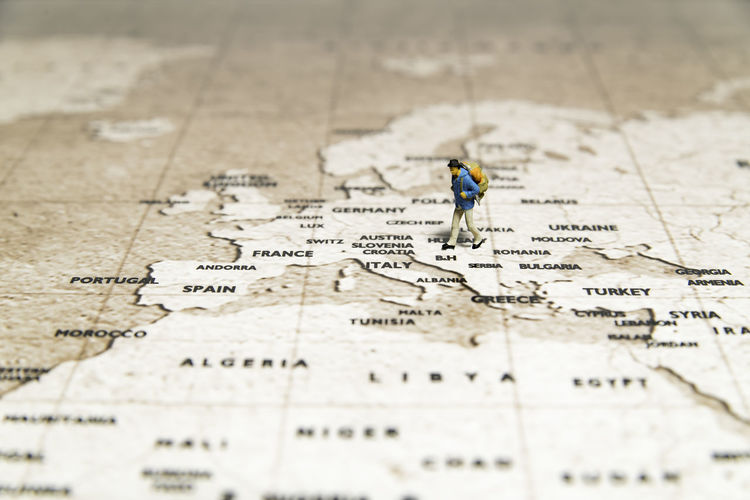 Tiny traveler model walk on map Americana BackpackersMemories Tourists Travel Photography African Beauty Asian Food Cartography City Close-up Day Direction Discovery Europa Global Communications Guidance Map No People Physical Geography Selective Focus Text Topography Tourism Malaysia World Map On Ceilling