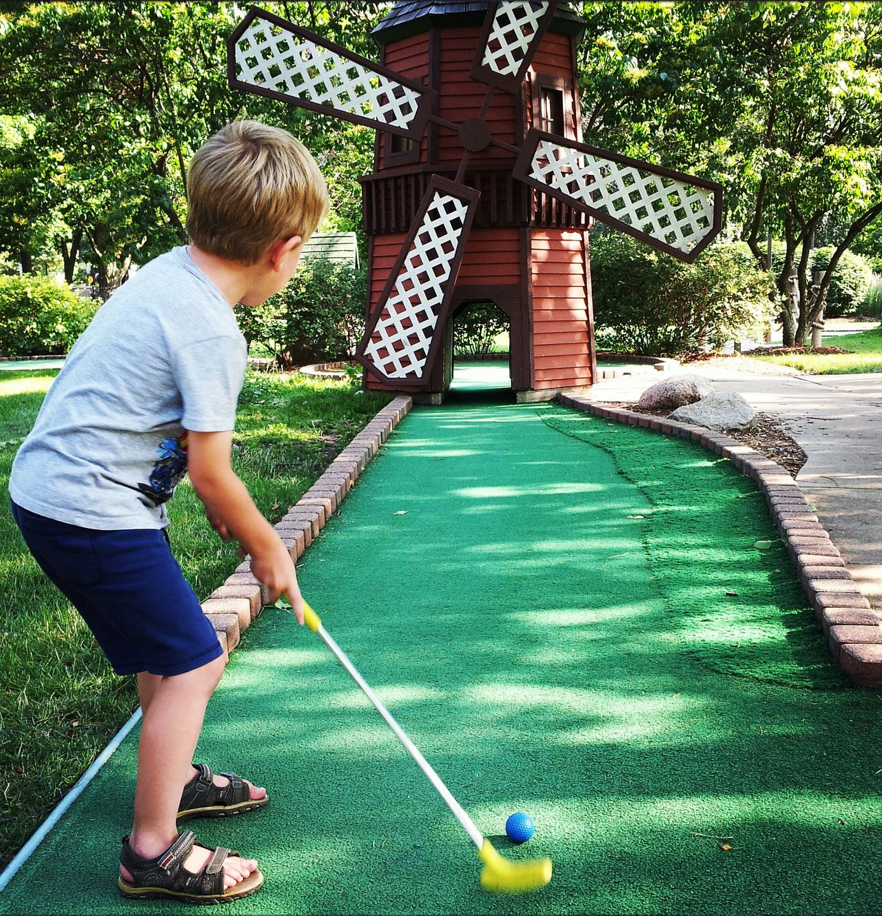 Beautiful stock photos of golf, Ball, Blonde Eyes, Casual Clothing, Childhood