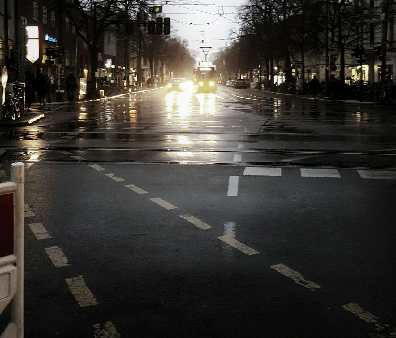 Coming home these days... Traffic Lights City Tram Cable Car Wet Road Wet Ground Wintertime Cold Day Rainy Days Rainy Weather City Lights Street Lights Coming Home Traffic Street Car Transportation Outdoors Wet Water Road Building Exterior No People Architecture Embrace Urban Life