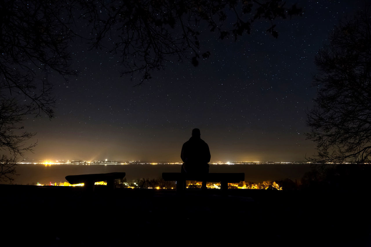 Astronomy Beauty In Nature Galaxy Nature Night Nightphotography Nightshot One Person Outdoors People People Photography Real People Relaxation Scenics Silhouette Sitting Sky Solitude Star - Space Stars Tranquil Scene Tranquility Tree