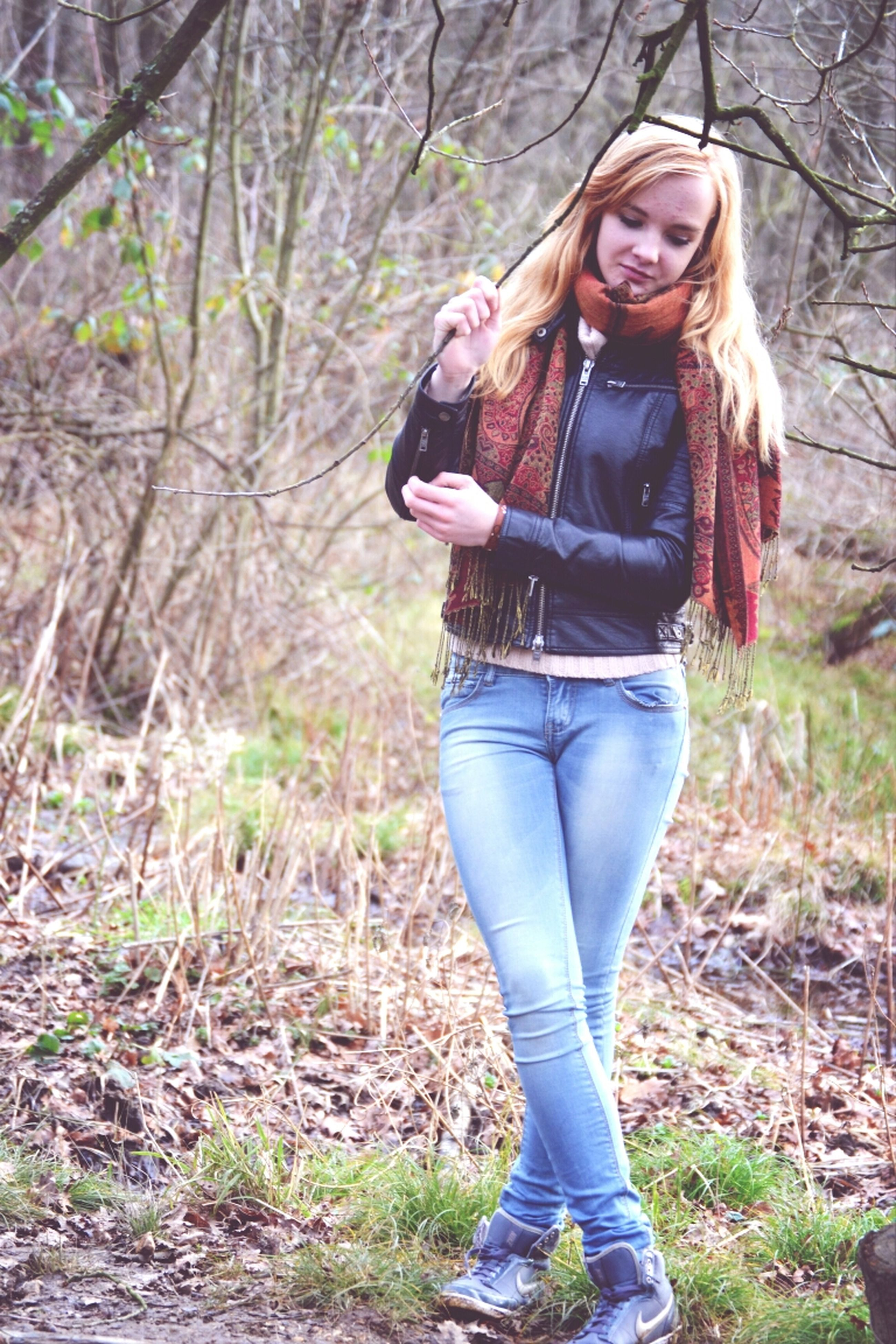 young adult, lifestyles, person, casual clothing, young women, standing, leisure activity, portrait, front view, three quarter length, looking at camera, long hair, tree, full length, sunglasses, jacket