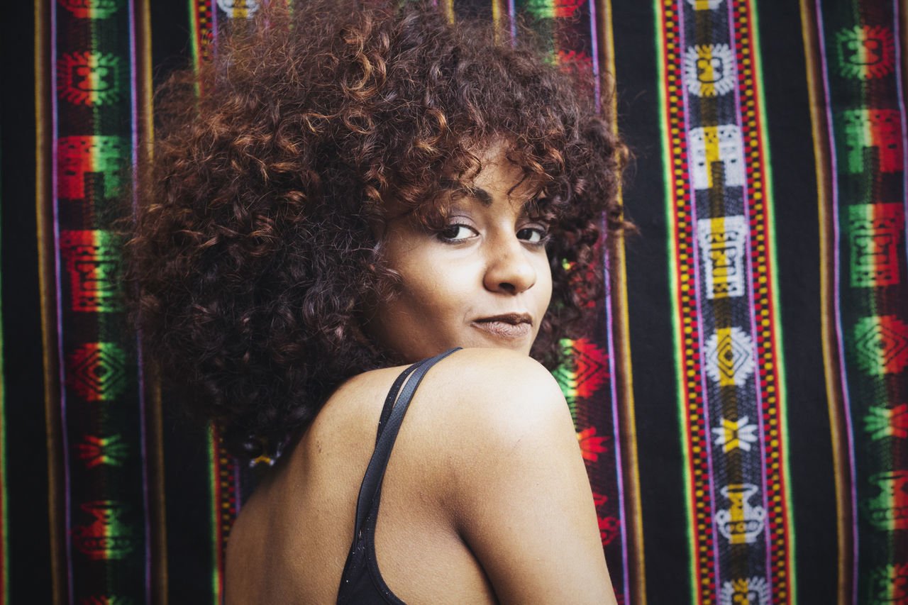 Adults Only Beautiful Woman Beauty Black Woman Close-up Contemplation Curly Hair Day Ethnic Pattern Etnic Fashion Headshot One Person One Woman Only One Young Woman Only Outdoors Pattern People Portrait Young Adult