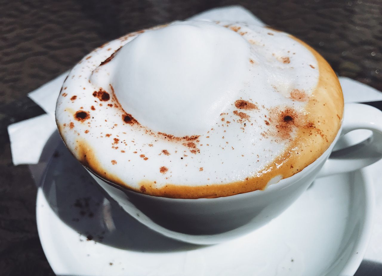 coffee cup, frothy drink, coffee - drink, close-up, drink, high angle view, food and drink, no people, saucer, indoors, freshness, cappuccino, froth art, day
