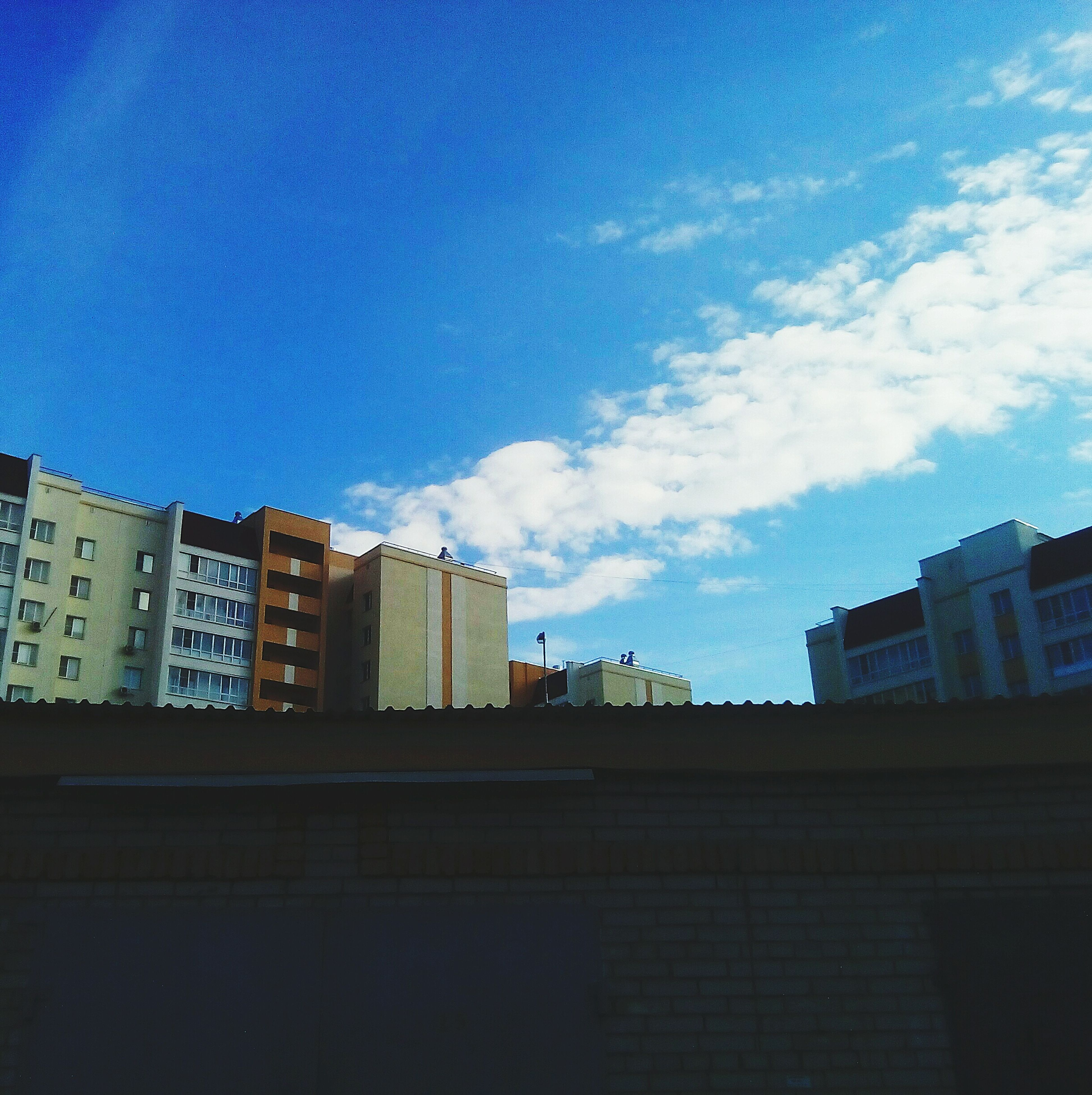 architecture, building exterior, built structure, sky, city, cloud, blue, day, cloud - sky, outdoors, city life, apartment, building story, urban skyline, cloudscape, no people, development, office building