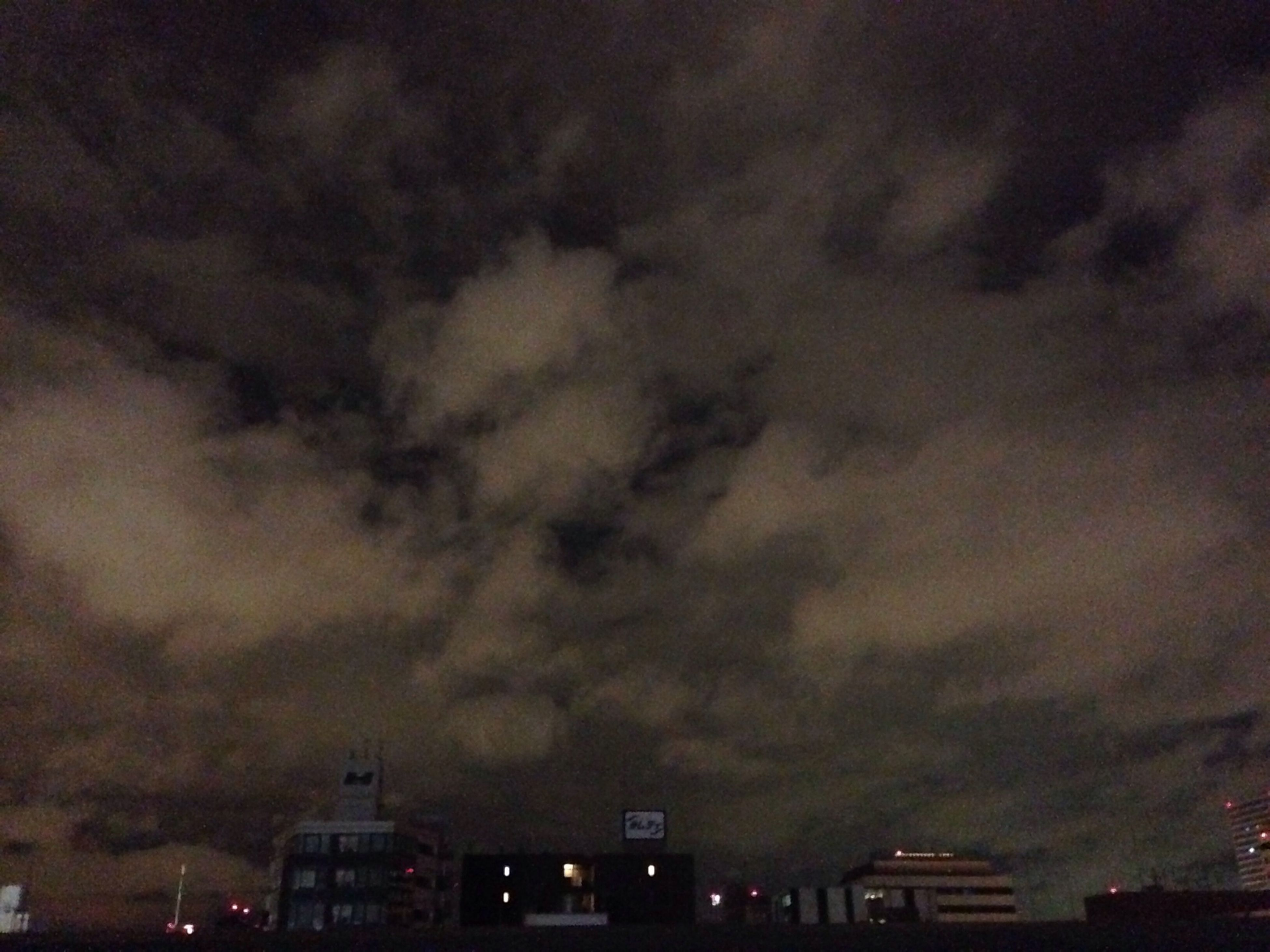 building exterior, sky, architecture, built structure, cloud - sky, cloudy, storm cloud, weather, overcast, night, city, dusk, illuminated, residential building, dramatic sky, residential structure, house, atmospheric mood, outdoors, low angle view