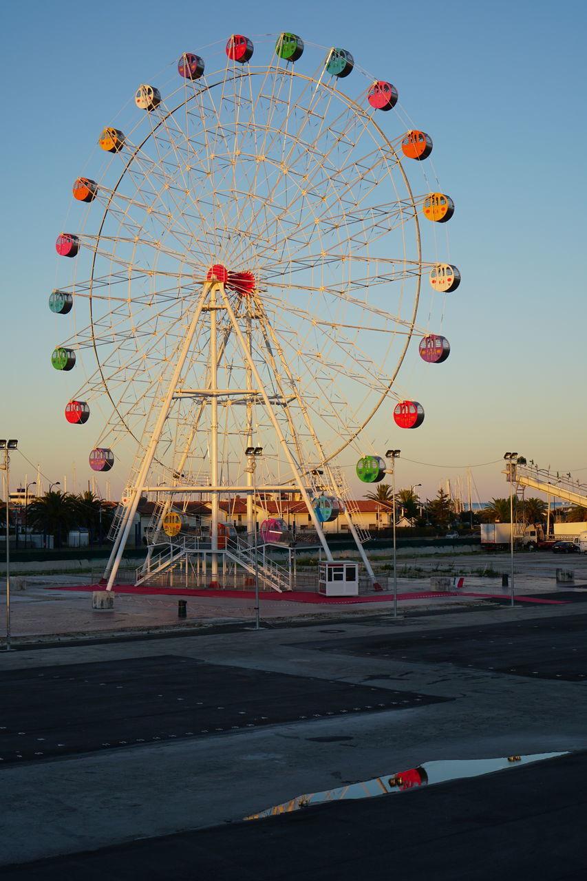 ferris wheel, amusement park, arts culture and entertainment, big wheel, amusement park ride, no people, built structure, clear sky, outdoors, sky, day, sunset, architecture, building exterior, cityscape