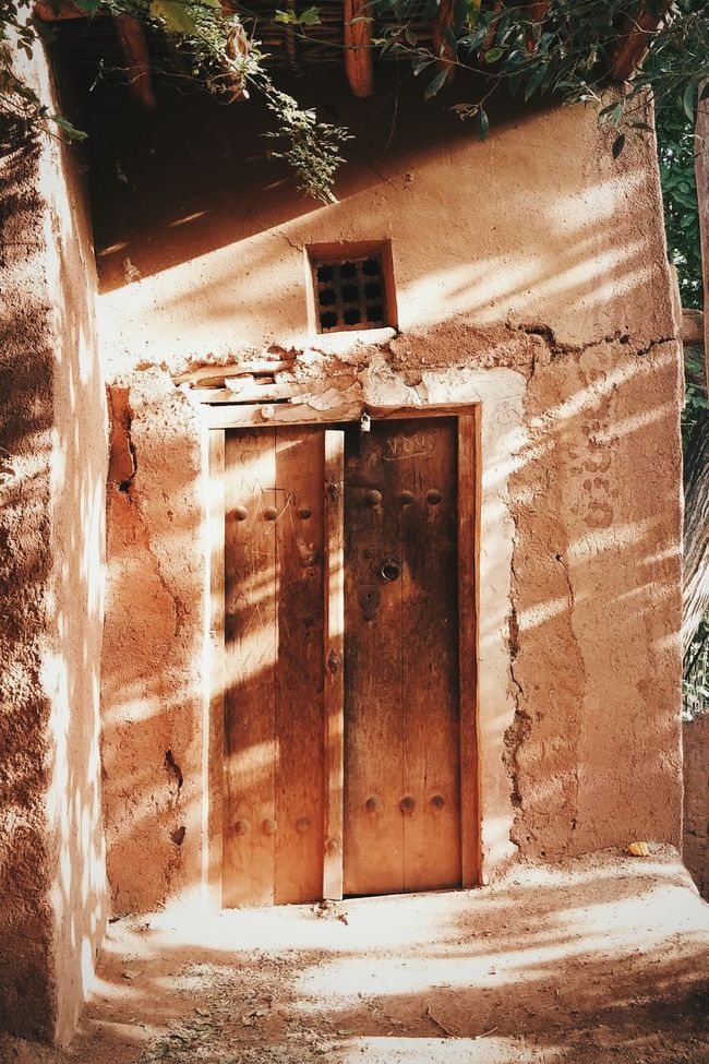 Walking in Abyneh in the summer afternoon and you csn see sun light casting throughout trees on houses. Light And Shadow Iran Street Photography Old Door