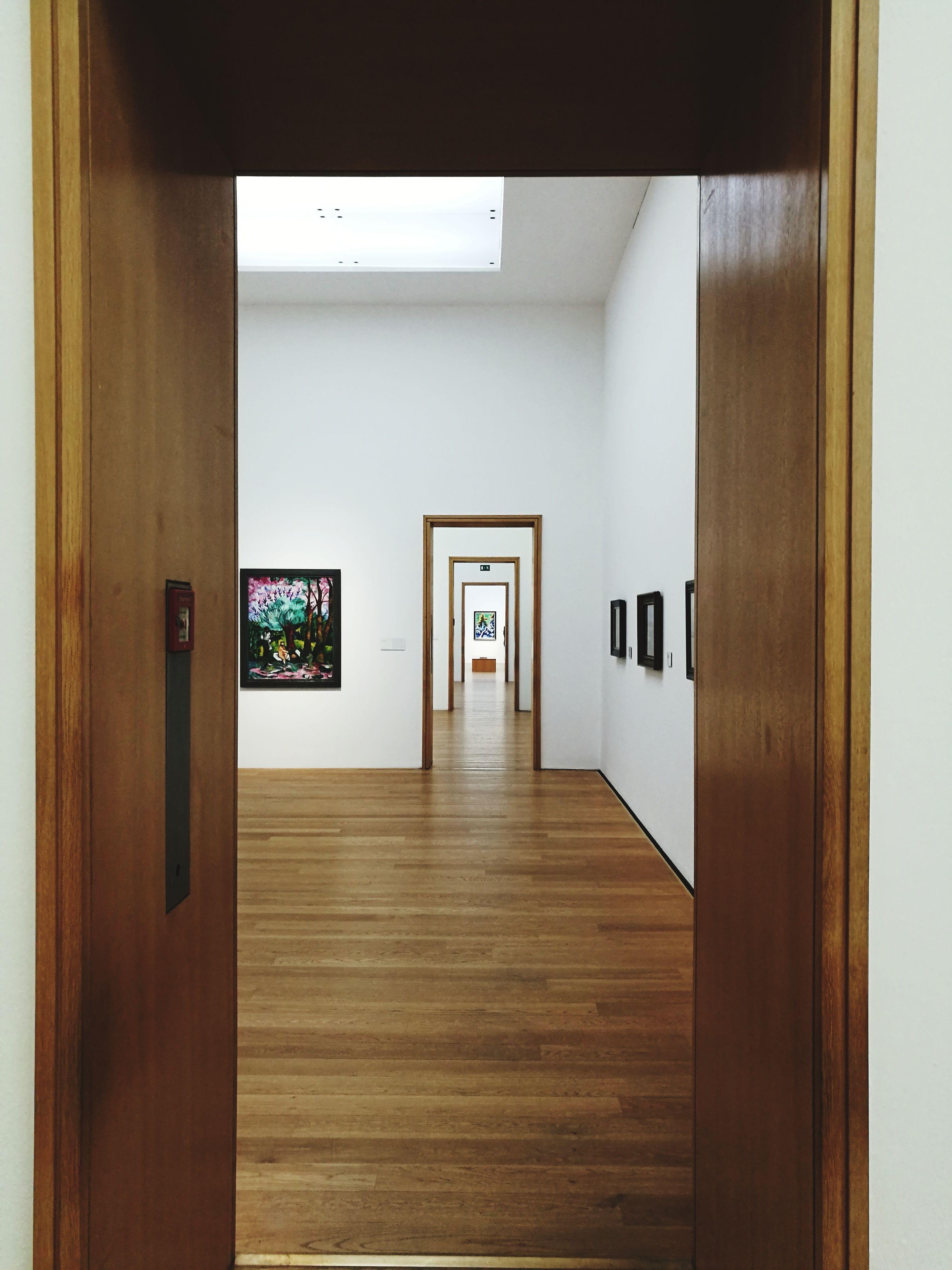 door, indoors, built structure, entrance, no people, architecture, day, open door, exit sign