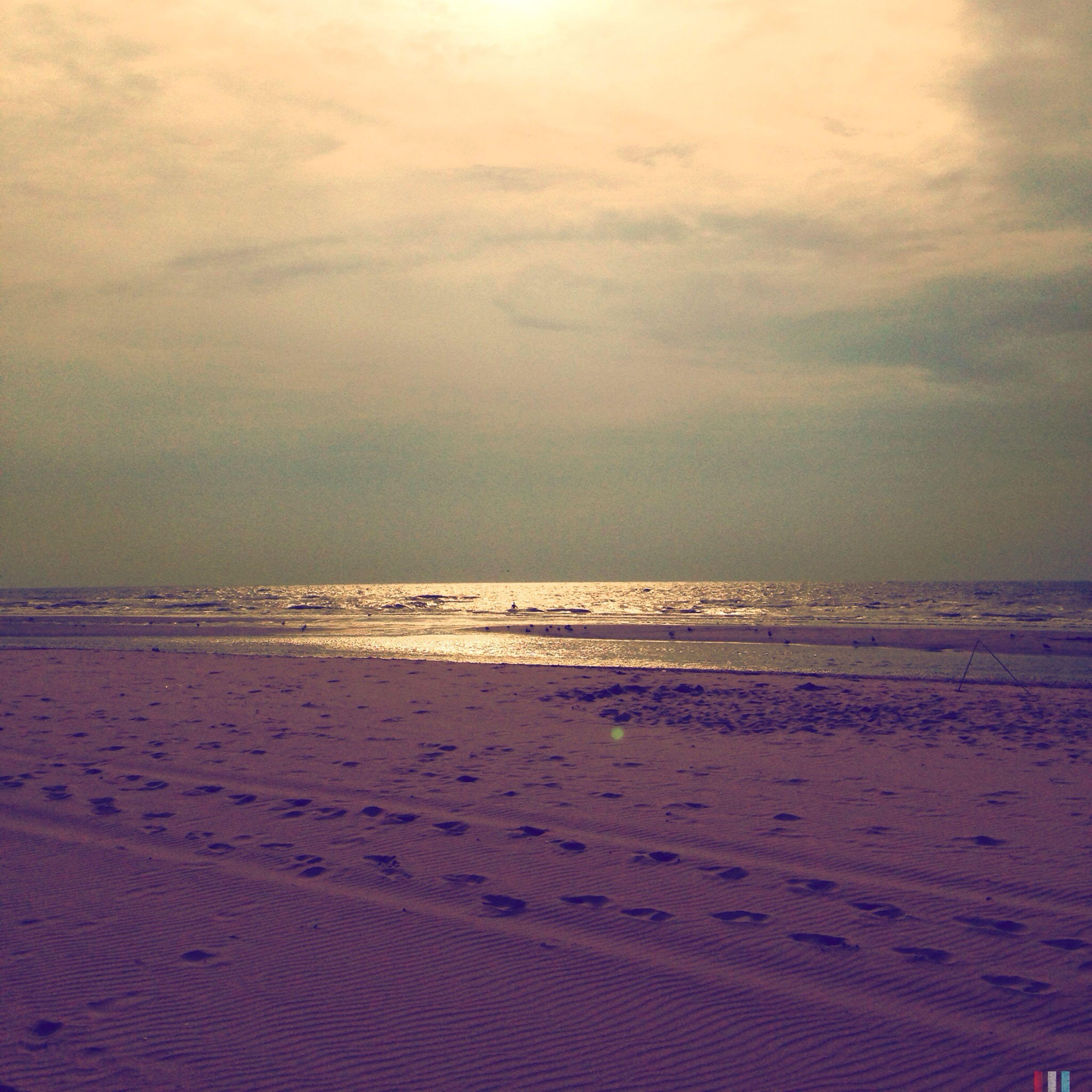 beach, sea, sand, horizon over water, tranquil scene, shore, tranquility, scenics, water, sky, beauty in nature, nature, sunset, idyllic, cloud - sky, coastline, remote, calm, wave, non-urban scene