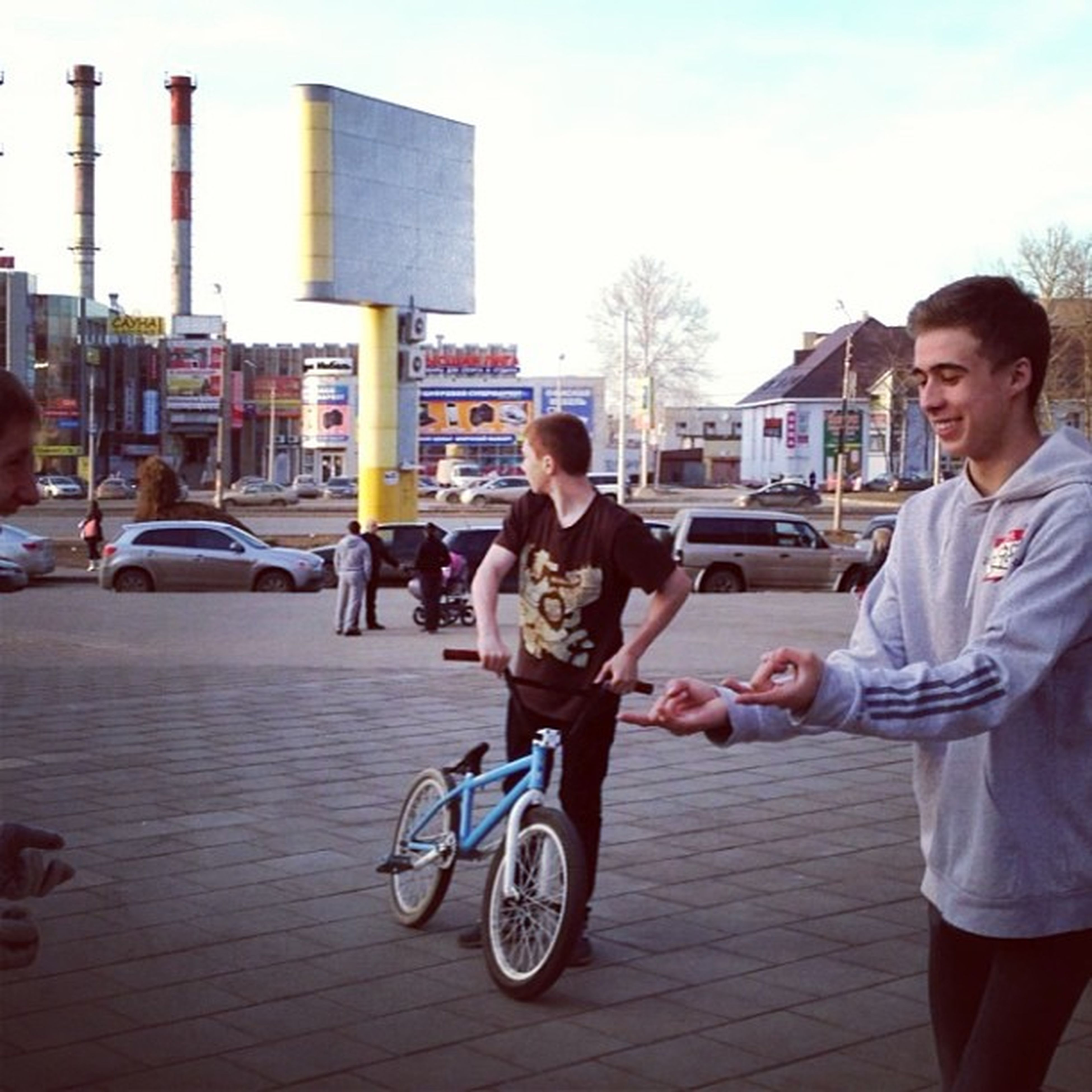 lifestyles, leisure activity, casual clothing, person, full length, land vehicle, transportation, building exterior, mode of transport, young adult, bicycle, architecture, city, street, built structure, city life, young men