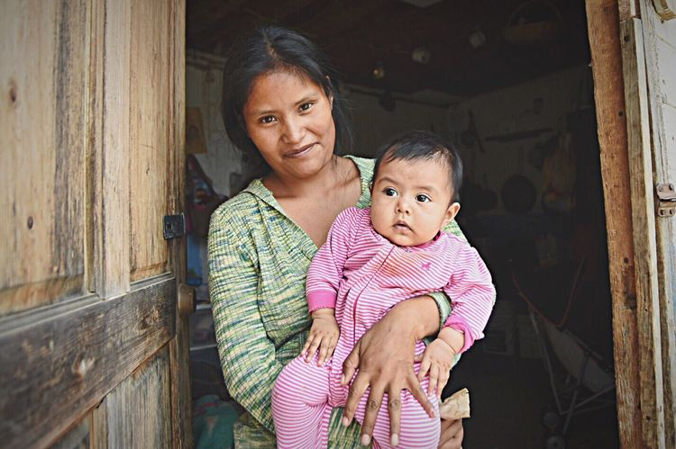 Martina's life is full of the daily challenges of raising 3 girls under the age of 6. Her concerns for the health, safety and well being of her children are no different than women who live less than 60 minutes from her home, but on the other side of the border. Unfortunately this minor geographic distance creates and additional layer of anxiety for women like her. Everyday she wonders if there will be food, diapers, water to drink, or if her husband will have work. Her children have increased risks of death from starvation, disease or misadventure, and there is no safety net. These worries along with no real social services or welfare, and dysfunctional and limited access to health care, are just a few reasons that men and women enter the United States illegally. Despite living in a one room house with no running water or electricity, Martina faces the future with hope that her children will thrive and overcome their circumstances. Women Who Inspire You Poverty Beyond The Border Mexico First Eyeem Photo Photojournalism Border Stories Women Woman Portrait Women And Children Documentary Documentary Photography The Photojournalist - 2016 EyeEm Awards The Portraitist - 2016 EyeEm Awards The Following