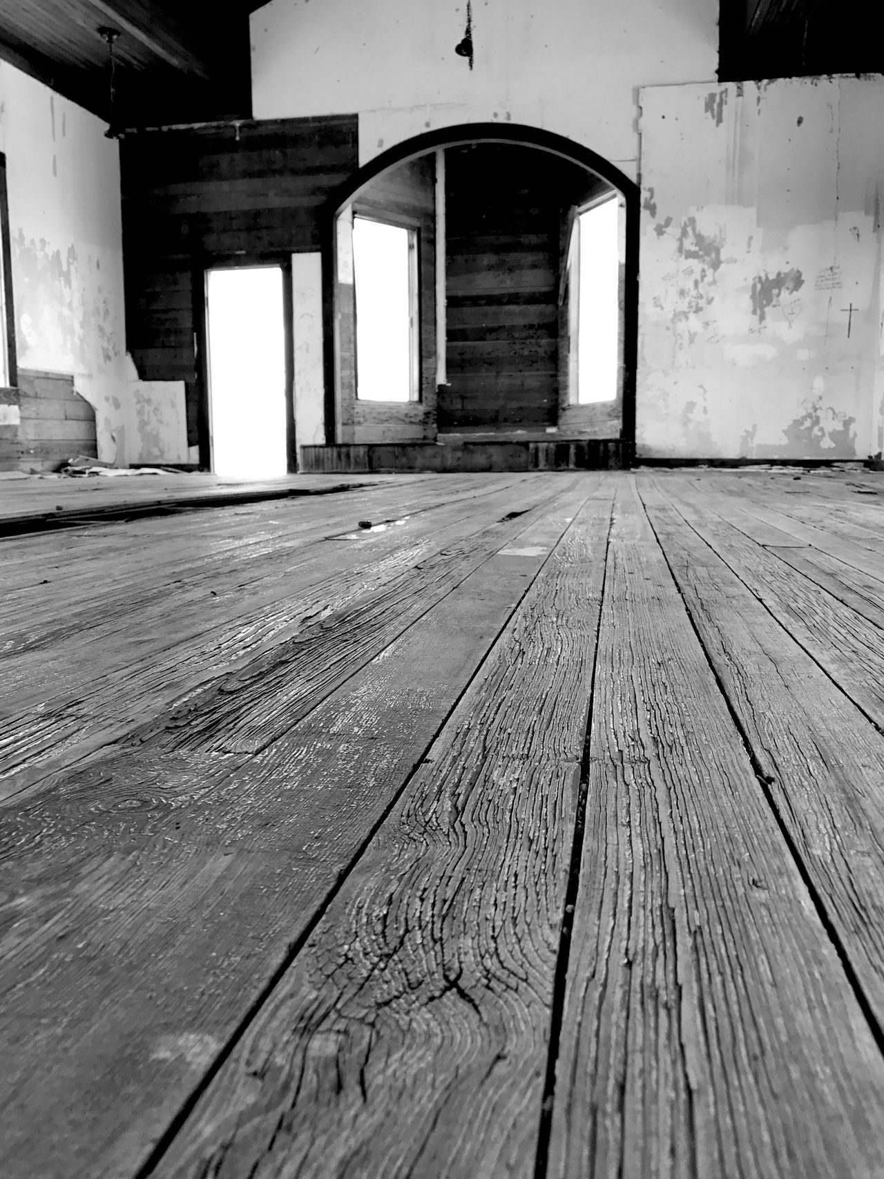 """""""Knee View"""" Sometimes on your knees is the only place you can be. The sanctuary of the long abandoned Taiban, New Mexico Presbyterian Church, built in 1908. Architecture Wood - Material Indoors  Woodfloor Church Sanctuary  Onyourknees New Mexico Abandoned Places Abandoned Ghost Town Newmexicophotography Blackandwhite Black & White Blackandwhite Photography"""