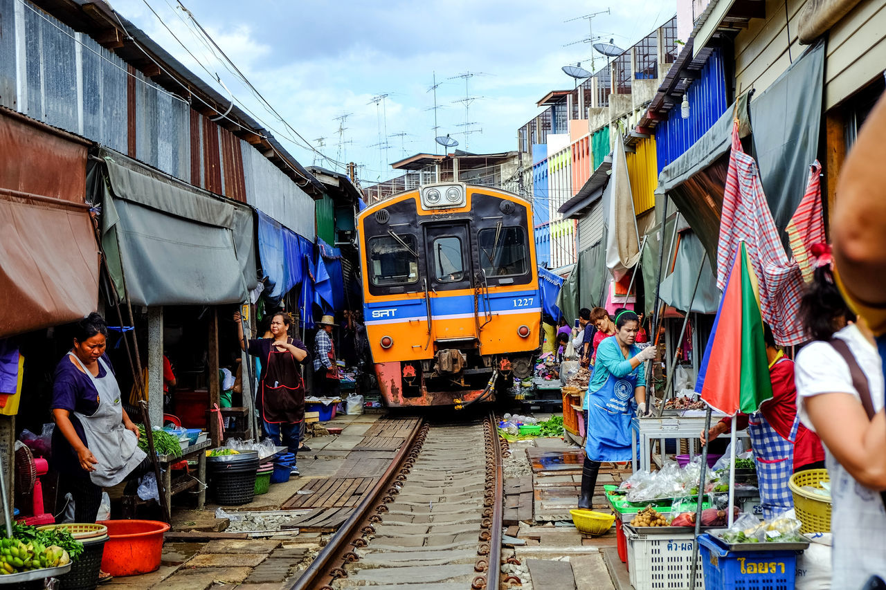Rom Hub Market (Maeklong Railway Market). with a unique tourist attractions. To close the umbrella in the train went into and out of the station. Antique ASIA Attraction Building Exterior Day Landmark Maeklong Maeklong Railway Market Market Market Place Men Outdoors Railway Real People Sky Thailand Tourism Tourist Tourist Attraction  Train Travel Vacation Destination Vacation Time
