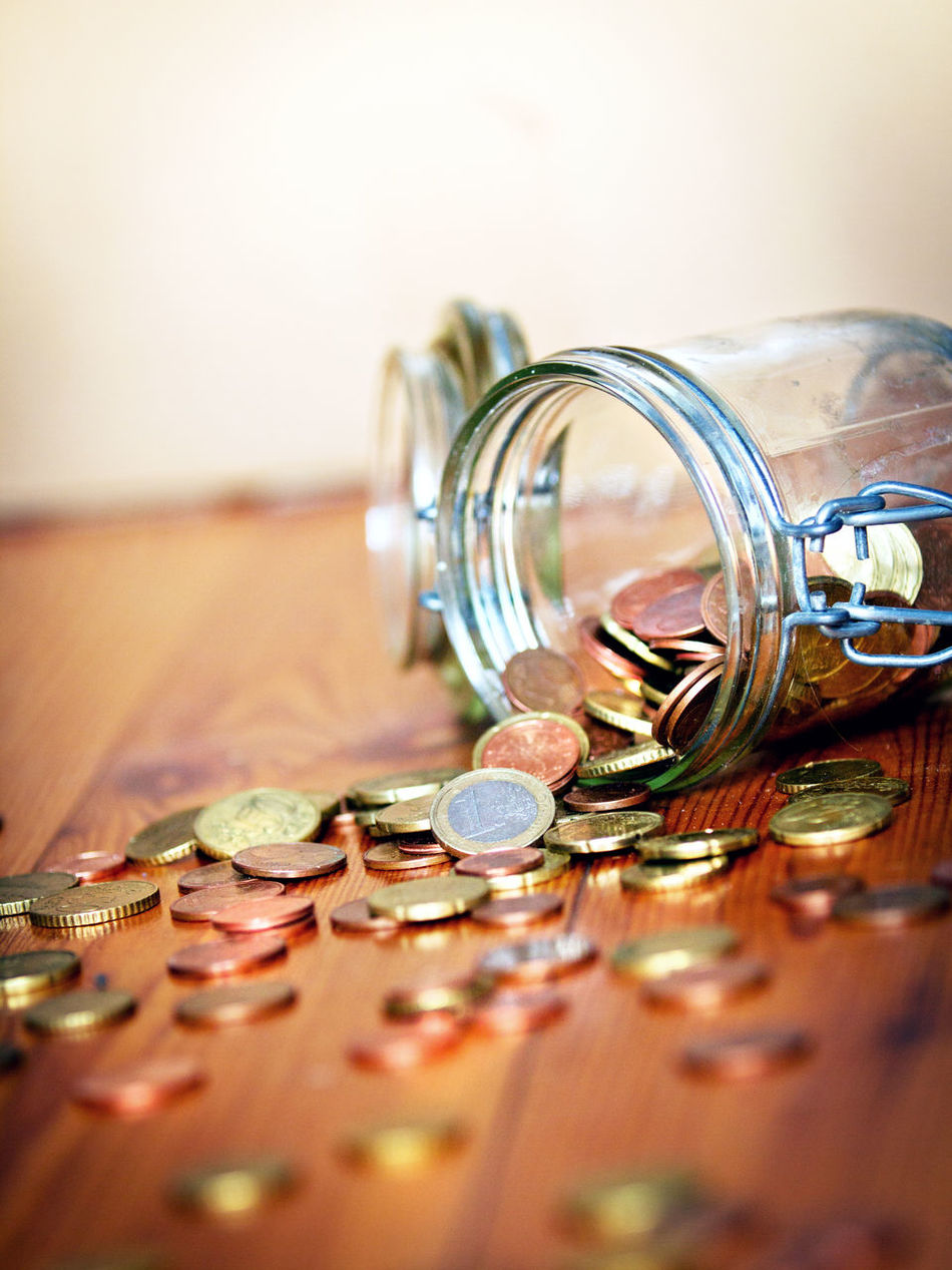Blurred Background Cash Close-up Coin Coins Day Earnings Empty Euro Glass Indoors  Many Money No People Pension Piggy Bank Poverty Save Up Savings Wooden Table