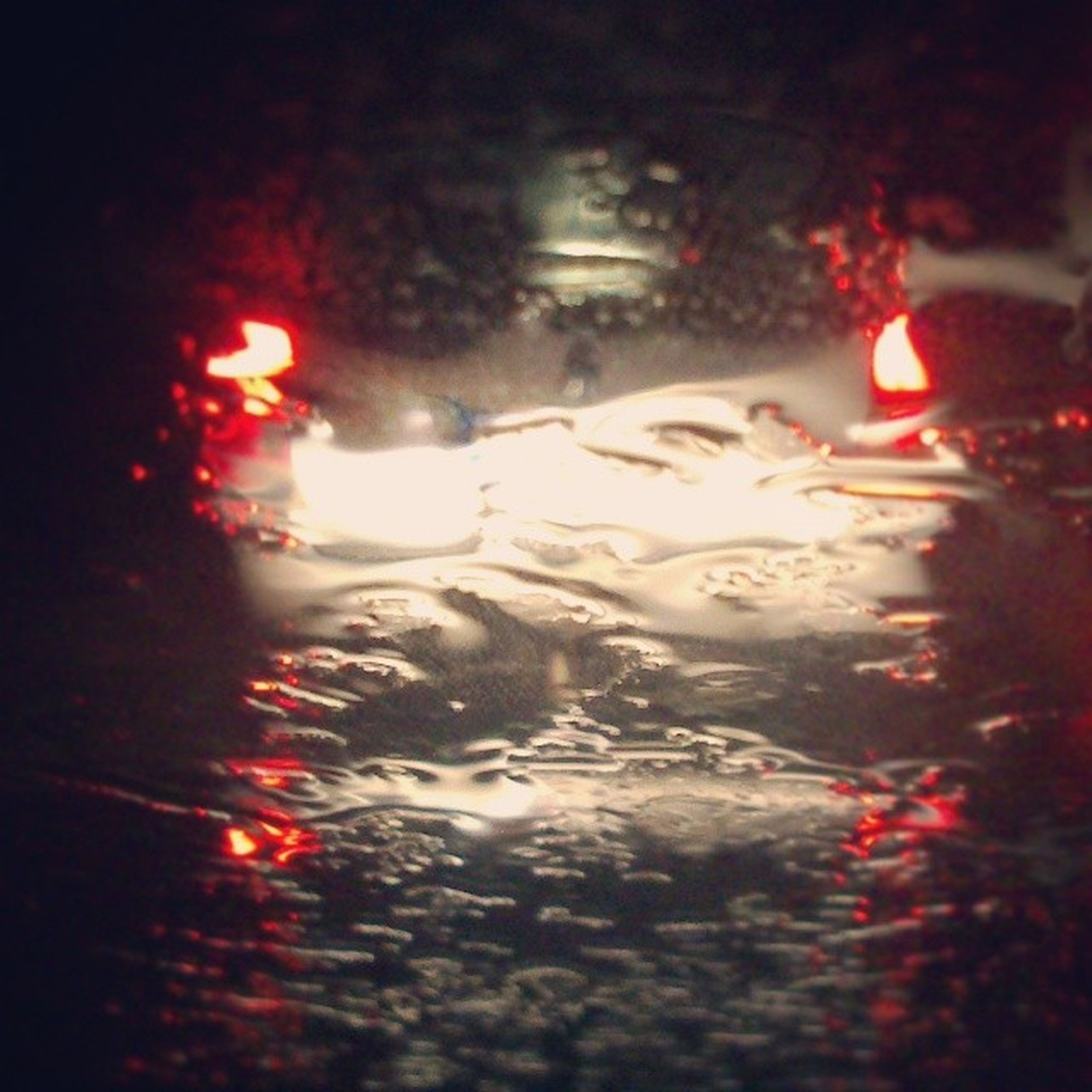 wet, rain, illuminated, night, street, water, reflection, puddle, season, weather, red, drop, transparent, glass - material, road, monsoon, indoors, window, car