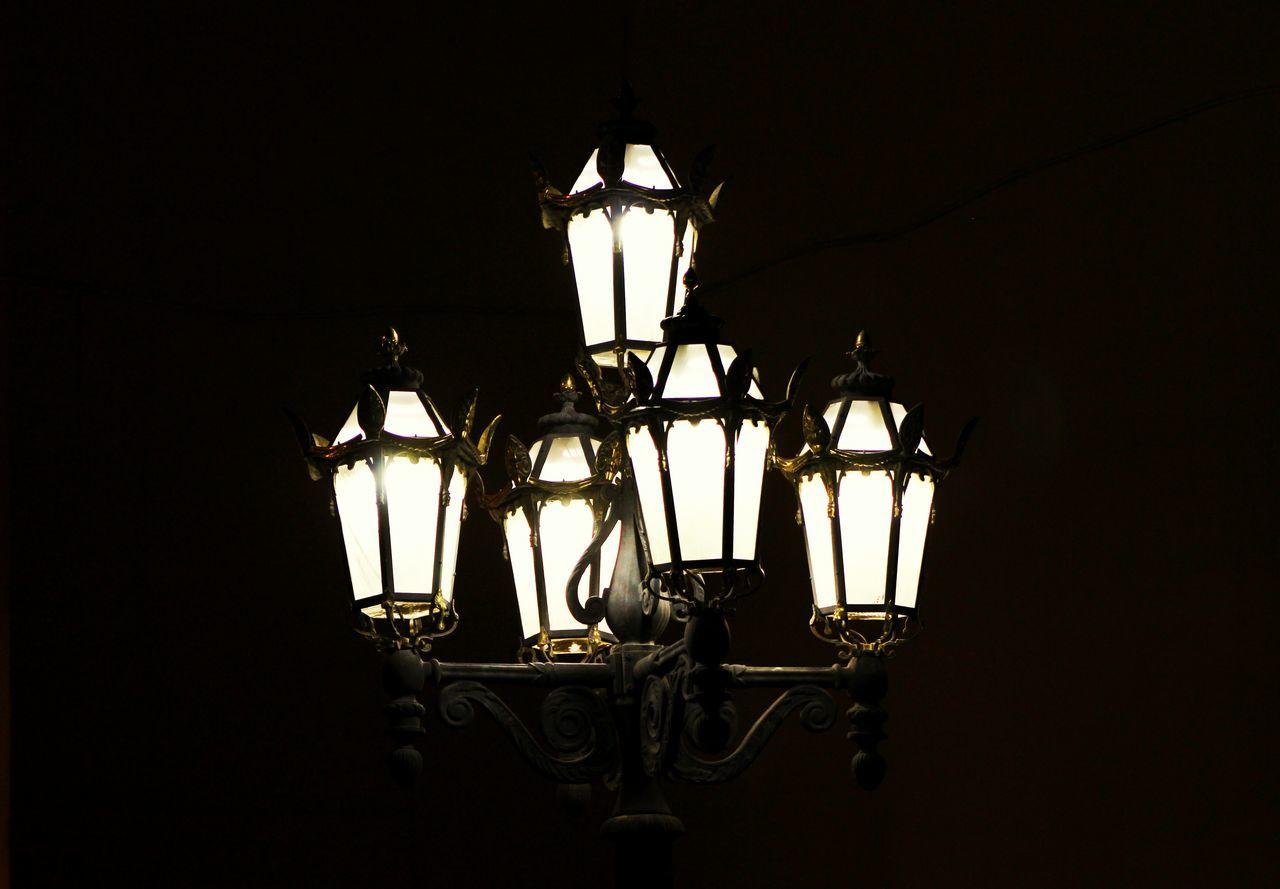 Illuminated Lamp Posts At Night