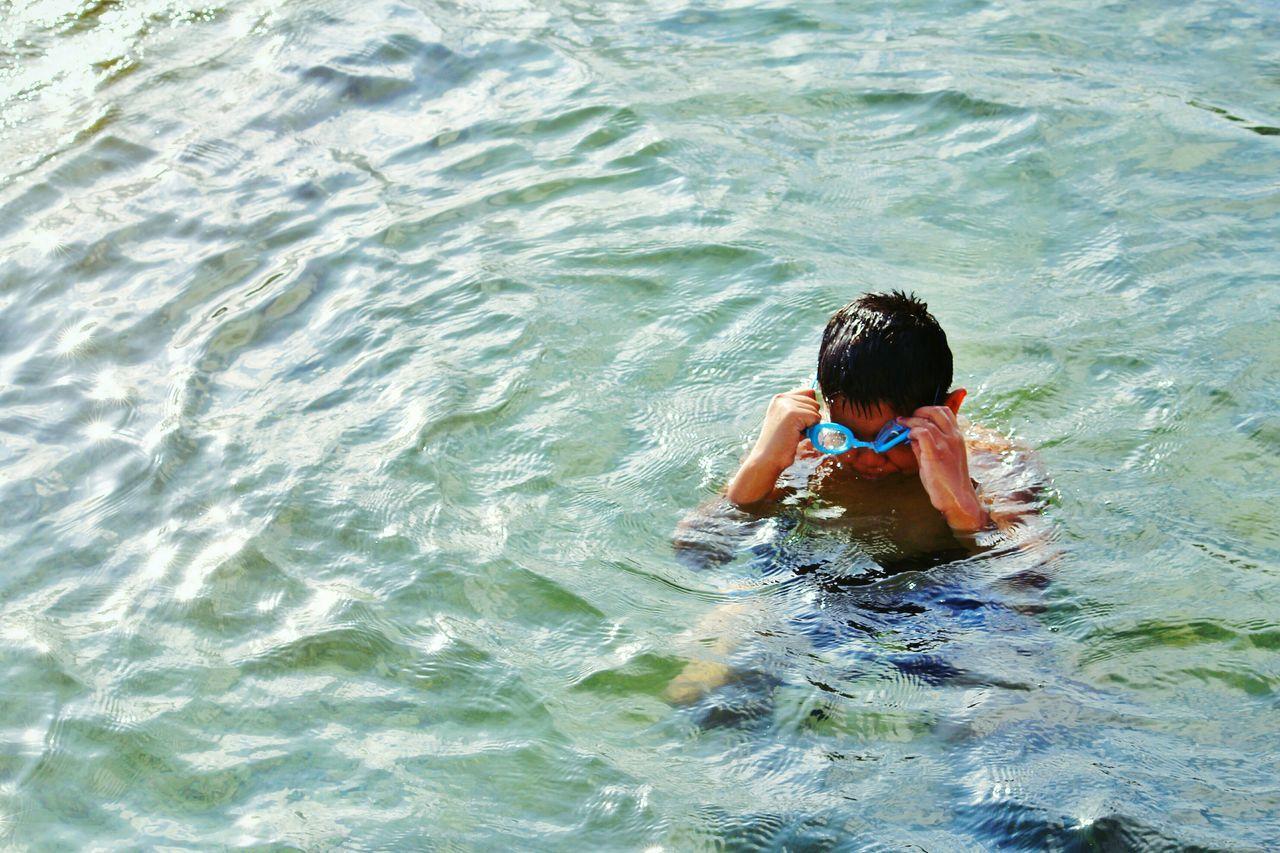 Summer is here. Being A Beach Bum Swimming Getting A Tan Beach Beach Day Swimming At The Beach Enjoying The Beach Water Fun Enjoying The Water Children Swimming Eyeem Photography Eyeem Philippines The Week On EyeEm Manila Philippines