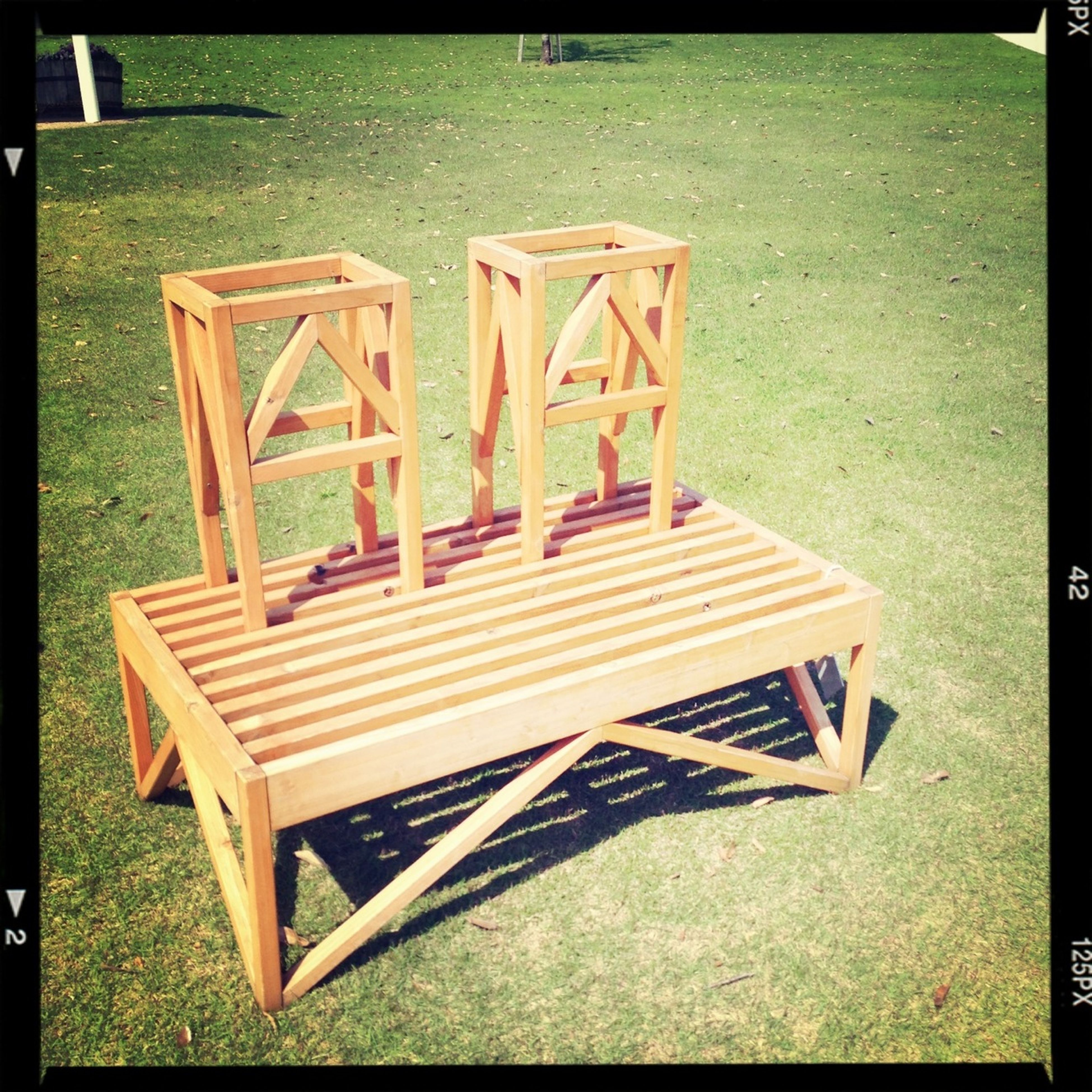 transfer print, bench, empty, grass, auto post production filter, absence, chair, wood - material, park bench, seat, park - man made space, wooden, relaxation, tranquility, sunlight, wood, day, railing, shadow, outdoors