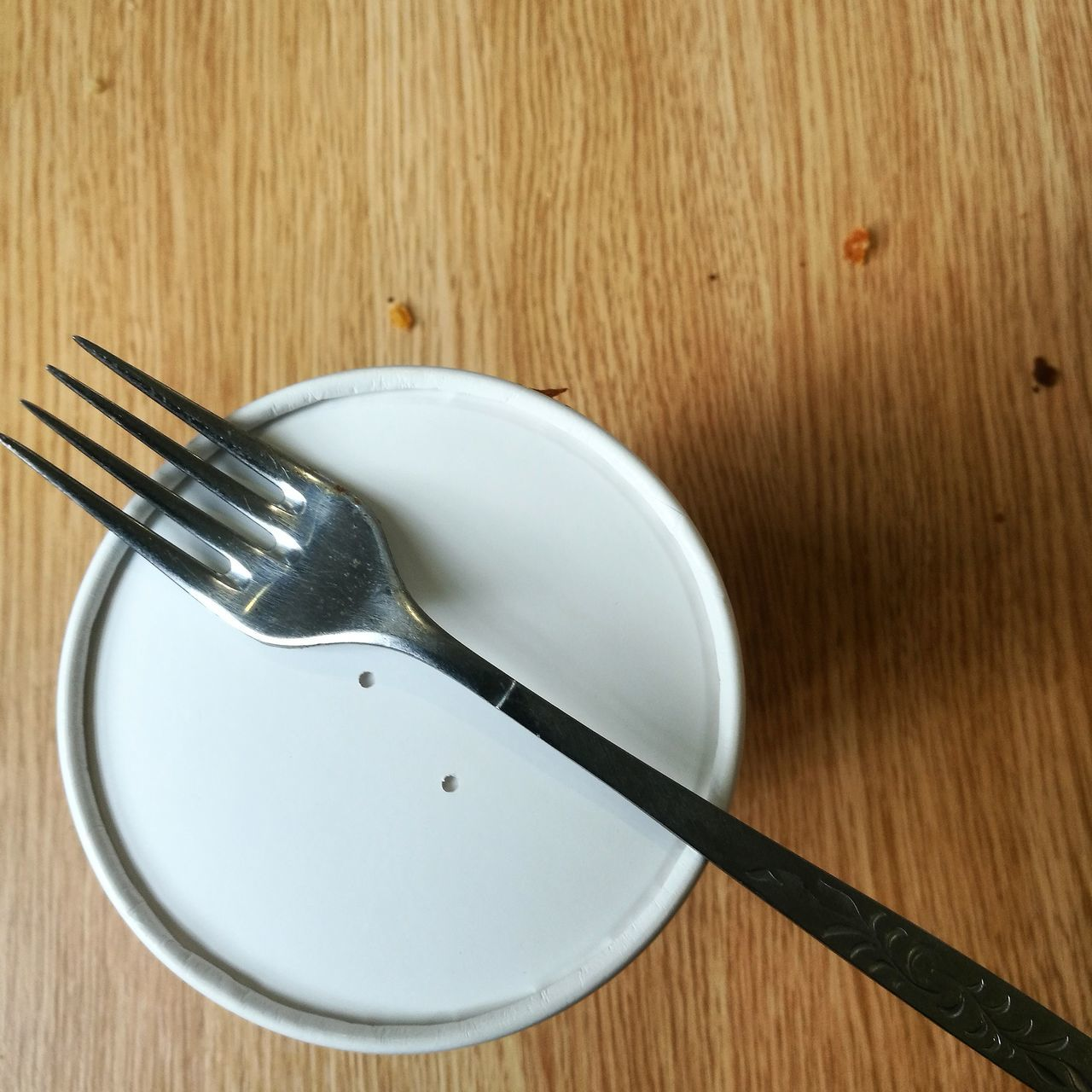 fork, wood - material, table, plate, directly above, high angle view, food and drink, no people, cutlery, indoors, food, close-up, leftovers, freshness, day