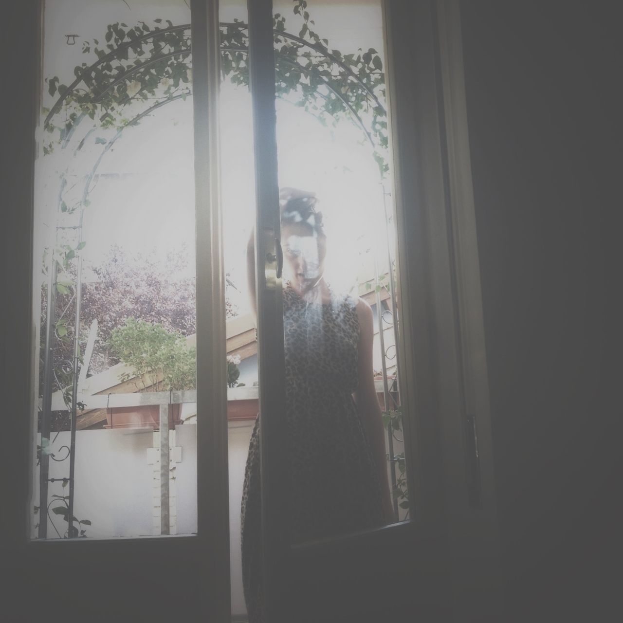 window, one person, looking at camera, front view, young adult, real people, young women, standing, indoors, portrait, looking through window, day, beautiful woman, leisure activity, home interior, lifestyles, people