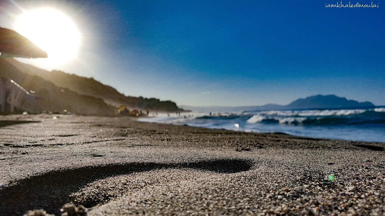 summer 2017 Beach Sand Sea Nature Water Sky Outdoors Sunlight No People Beauty In Nature Day Tranquility Wave Sunset Horizon Over Water Close-up Pebble Beach Pebble Scenics