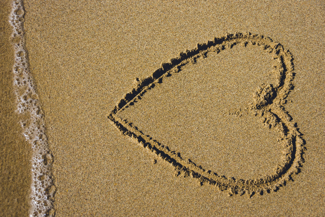 Heart shape drawn in the sand with sea foam at beach in Thailand. <3 Beach Concept Day Drawn Foam Heart High Angle View Holiday Love No People Romance Sand Sea Shape Shore Summer Sunset Symbol Thailand Together Togetherness Travel Vacation Valentine