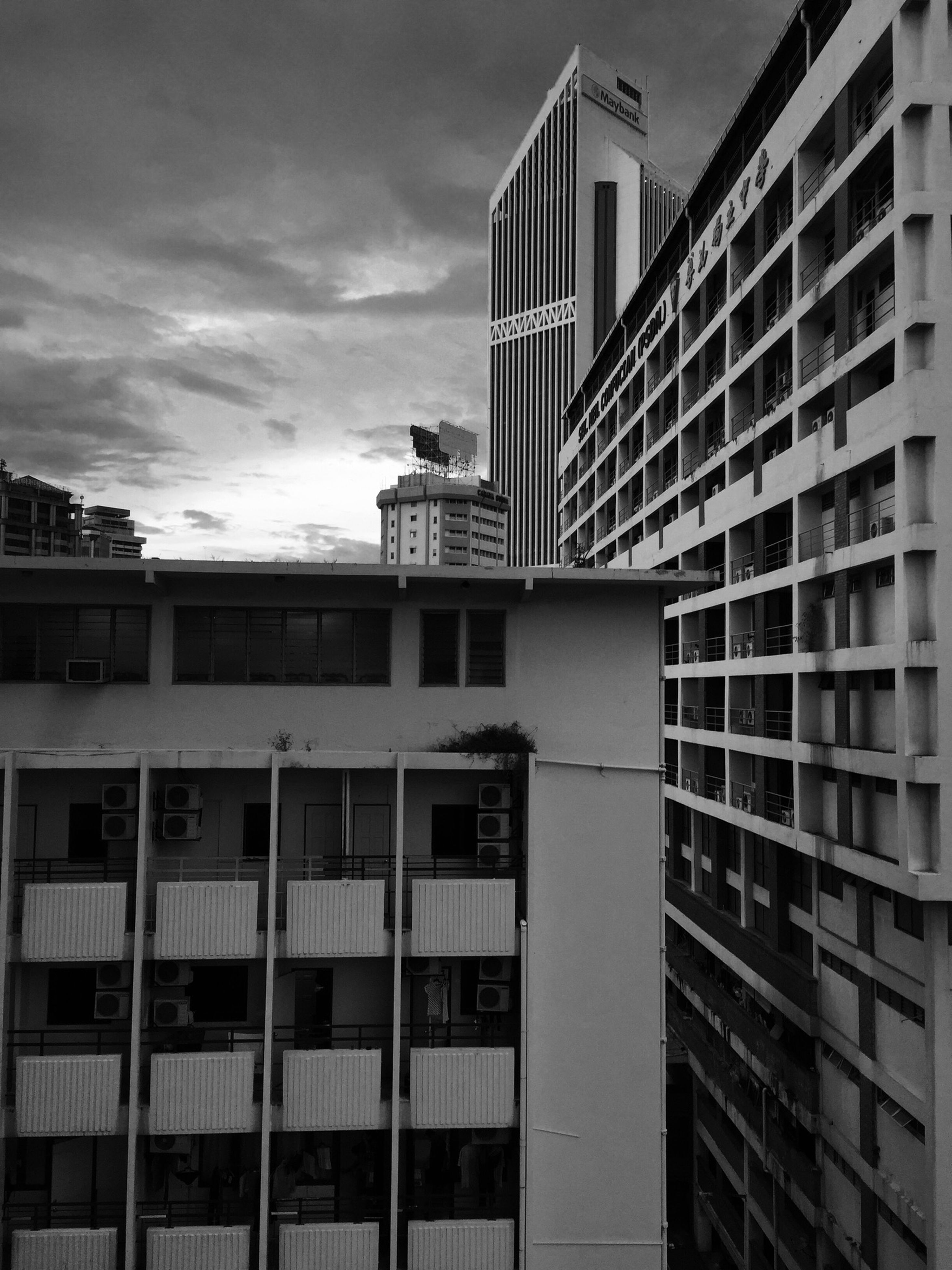 architecture, building exterior, built structure, window, building, low angle view, sky, residential building, city, residential structure, modern, day, cloud - sky, outdoors, balcony, in a row, apartment, office building, no people, cloud
