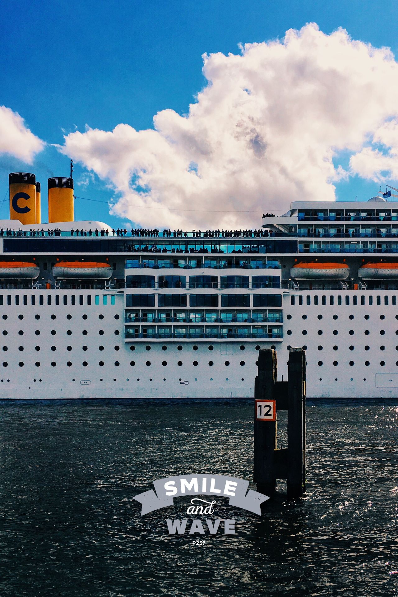 Just smile and wave boys... Smile and wave. P257 Onephotoaday IPhoneography 365project2016 Amsterdam Outdoors Blue Sky Dutch Skies Cruise Cruise Ship River Riverside Departure Departing People People Watching Ship Huge Typography Just Smile And Wave Clouds And Sky Manmade