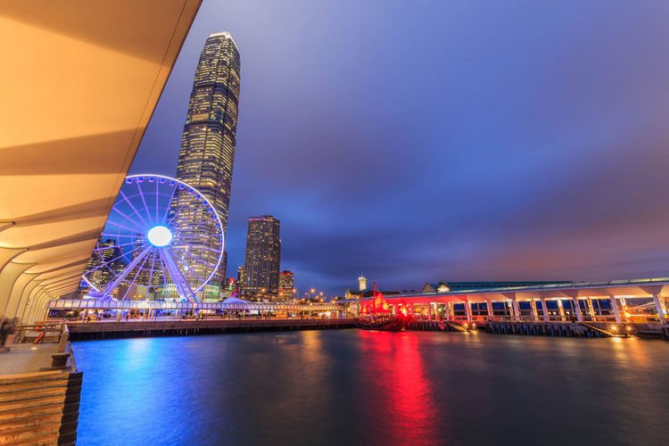 Observation Ferris Wheel in Hong Kong City Night Light Architecture Bridge - Man Made Structure Building Exterior City City Life Cityscape Cultures Downtown District Harbor HONG KONG LANDMAR Illuminated Modern Night No People Outdoors Reflection Representing Sky Skyscraper Suspension Bridge Tower Travel Travel Destinations Urban Skyline Water
