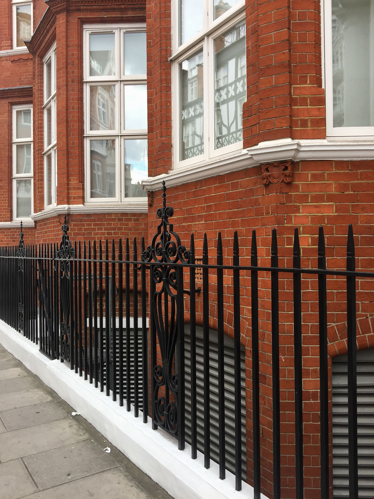 Beautiful West Kensington architecture in London. Gate Ironwork  Kensington London Architecture Brick Building Exterior Built Structure Day No People Outdoors Railing Residential Building Residential District Window Wrought Iron